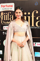 Cute Rakul Preet Singh in Deep Neck Cream Crop top Choli and Ghagra at IIFA Utsavam Awards 001.jpg]